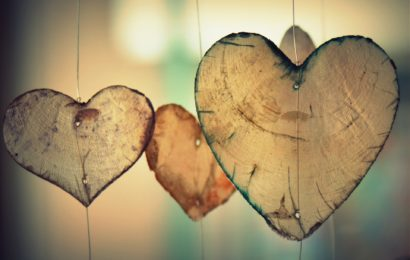 Three heart shapes made from wood