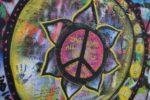 round multicolored peace sign wall art