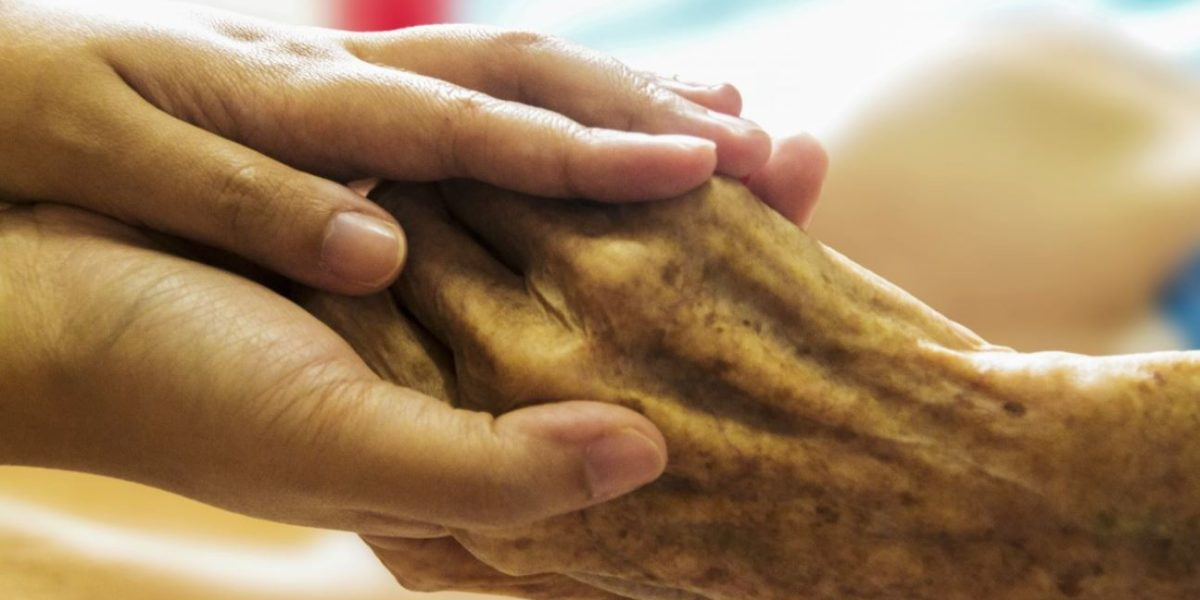 old and young hands touching